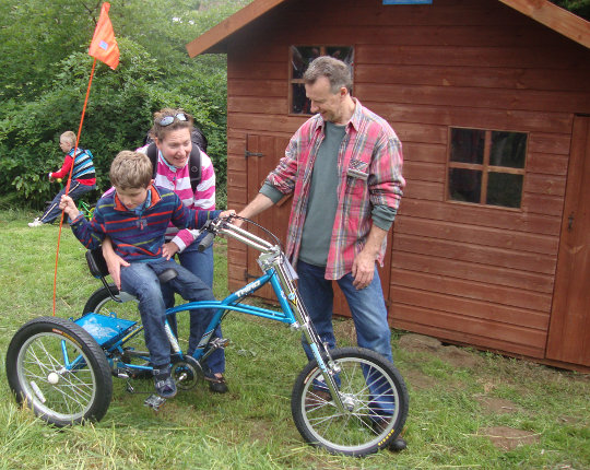 The new tricycle & playhouse the Rotary Club have raised funds for - with our 'poster boy' Ben trying out when it arrived!